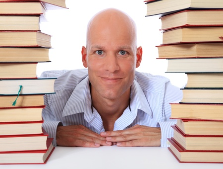 express positivity: Attractive middle age man between two piles of books. All on white background.