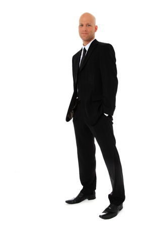 Full length shot of an attractive man wearing black suit. All on white background.  Stock Photo - 11544859