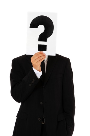 insecure: Businessman holding question mark in front of his head. All on white background.