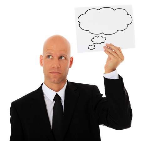 Attractive businessman holding speech bubble next to his head. All on white background.  Stock Photo