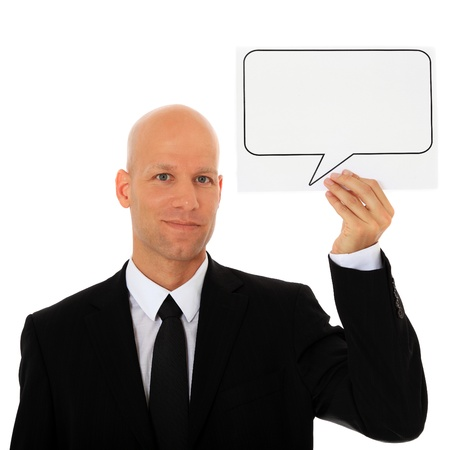 Attractive businessman holding speech bubble next to his head. All on white background.  photo