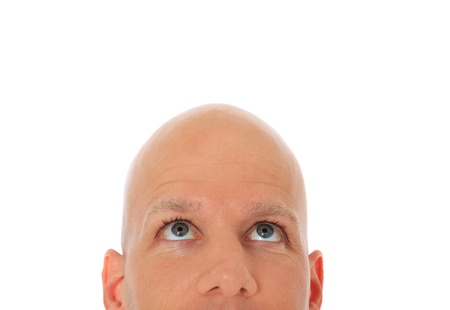 curious: Head of bald man looking up. All on white background.  Stock Photo