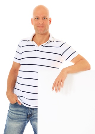 express positivity: Attractive middle age man leaning to blank white sign. All on white background.
