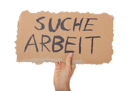 Male person holding cardboard sign with the german term suche arbeit (Engl.: hunting for a job). All on white background.  photo