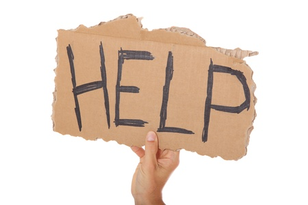 helpfulness: Male hand holding cardboard sign with the term help. All on white background.