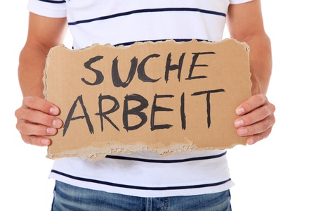 helpfulness: Male person holding cardboard sign with the german term suche arbeit (Engl.: hunting for a job). All on white background.  Stock Photo
