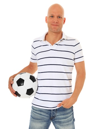 easy going: Attractive man holding soccer ball. All on white background.