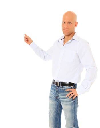 Attractive bald man pointing to the side. All on white background  photo