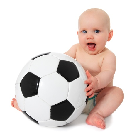 Cute caucasian baby playing with soccer ball. All on white background.  Standard-Bild