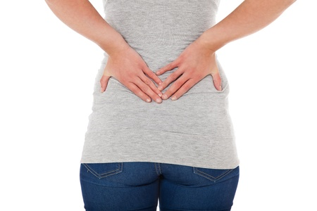 Female person suffers from backache. All on white background.