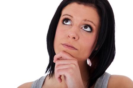 toma de decision: Mujer joven delibera una decisión. Todos en el fondo blanco. Foto de archivo