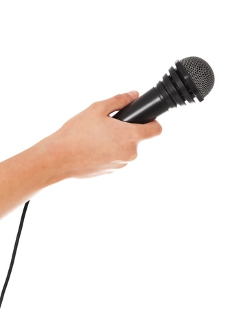 cloak and dagger: Person holding microphone. All on white background.