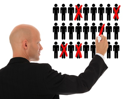 Businessman cutting back jobs. All on white background.  Standard-Bild