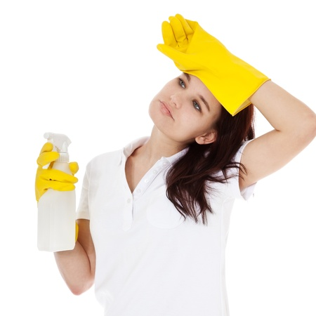 overwrought: Attractive woman makes an exhausted gesture during cleaning  All isolated on white background  Stock Photo