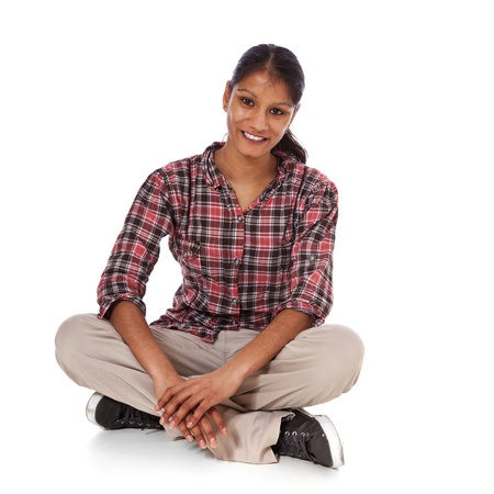 Full length shot of a young woman sitting on the floor  All on white background   Stock Photo