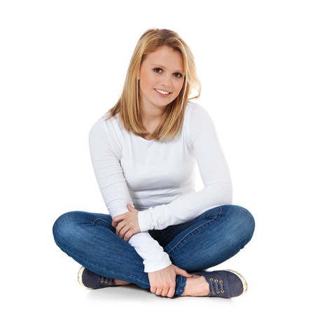 Attractive teenage girl sitting on the floor  All on white background Stock Photo - 12860031