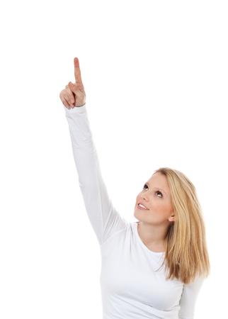 Attractive teenage girl pointing with finger  All on white background Stock Photo - 12859900