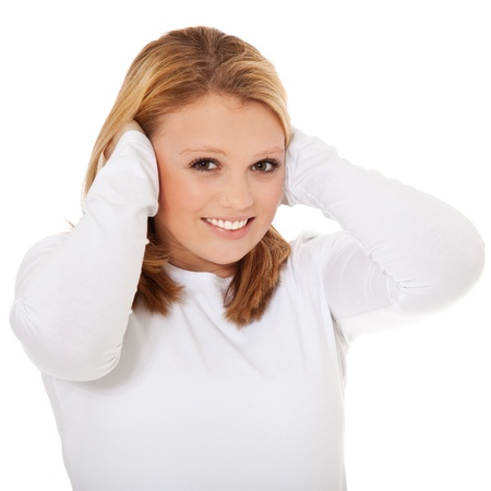 deafening: Attractive teenage girl keeps her ears shut  All on white background