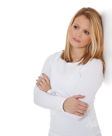 attractive charismatic: Attractive teenage girl leaning to wall  All on white background   Stock Photo