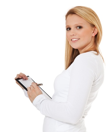 scandinavian descent: Attractive teenage girl doing a survey  All on white background