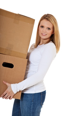 carry out: Attractive teenage girl carrying moving boxes  All on white background