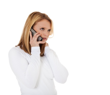 Attractive teenage girl getting bad news during phone call  All on white background Stock Photo - 12859907