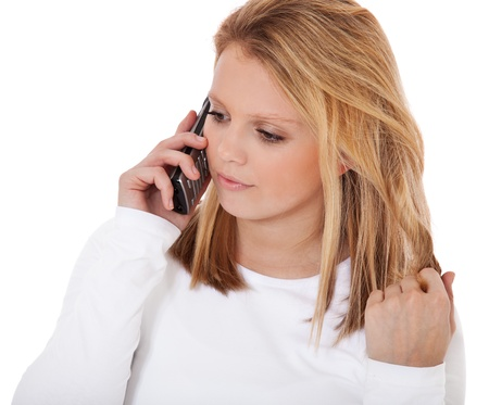 Attractive teenage girl talking on the phone  All on white background Stock Photo - 12860055