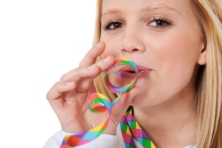 Attractive teenage girl having fun with colorful paper streamer  All on white background   photo