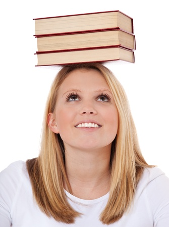 attractive charismatic: Attractive teenage girl balancing books on her head  All on white background  Stock Photo