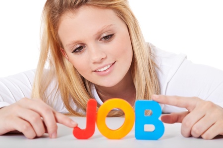 scandinavian people: Attractive teenage girl building the term job out of colorful letters  All on white background