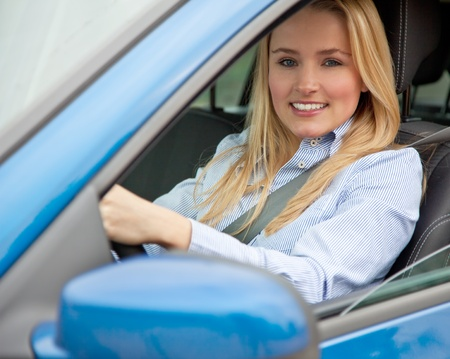 passed: Attractive young woman sitting in her car  Stock Photo
