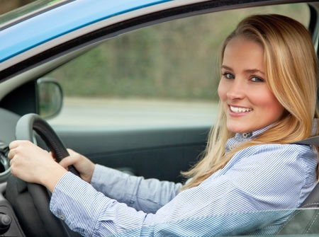Attractive young woman sitting in her car  Standard-Bild