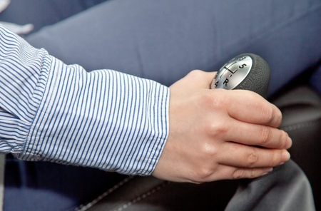 woman's hand: Woman�s hand uses gear change  Stock Photo
