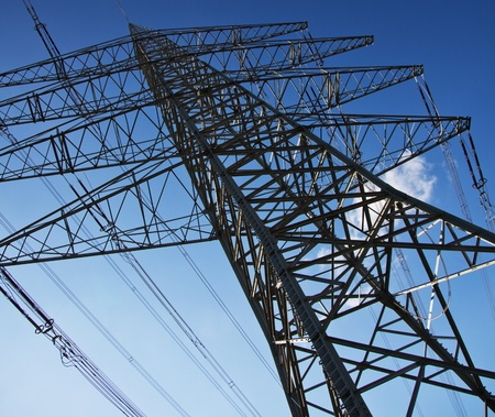 Single power pole infront of bright blue sky  photo