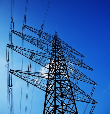 brigt: Single power pole infront of bright blue sky  Stock Photo