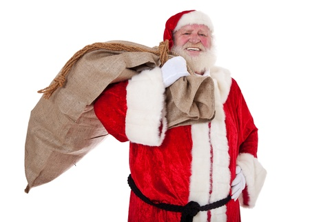 kris kringle: Santa Claus in authentic look carrying bag of presents  All on white background