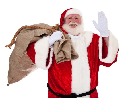Santa Claus in authentic look carrying bag of presents  All on white background   photo