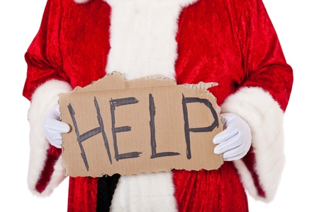 helpfulness: Santa Claus in authentic look holding cardboard sign showing the term help  All on white background  Stock Photo