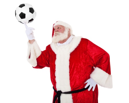 Santa Claus in authentic look playing with soccer ball  All on white background   photo