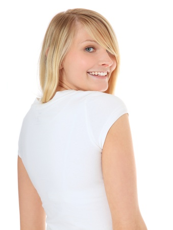 Attractive teenage girl looking over her shoulder  All on white background   photo