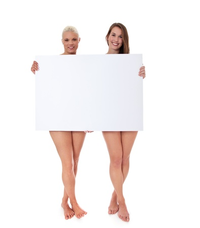 clothed: Full length shot of two barely clothed attractive women behind blank white sign  All on white background