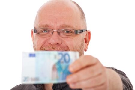 grownup: Casual grownup man holding twenty euro note