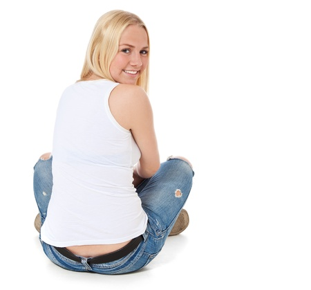 Rear view of an attractive teenage girl  All on white background   photo