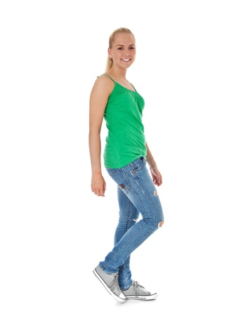 scandinavian descent: Full length shot of a walking girl  All on white background