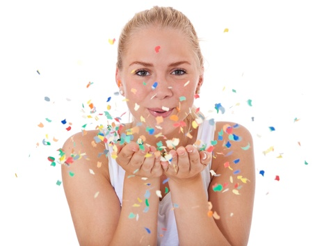 Attractive teenage girl having fun with confetti  All on white background   photo