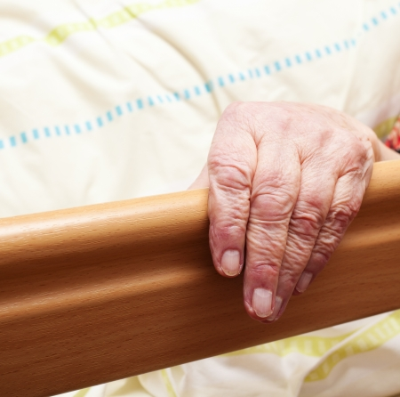 Care-dependent person lying in bed   Stock Photo - 14363901