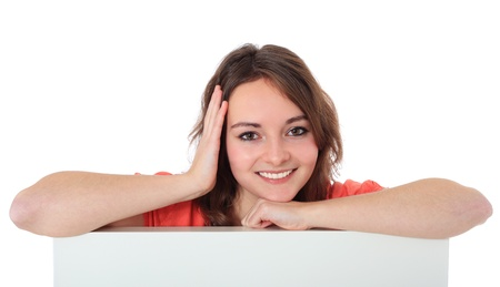 Attractive teenage girl behind white wall  All on white background   photo