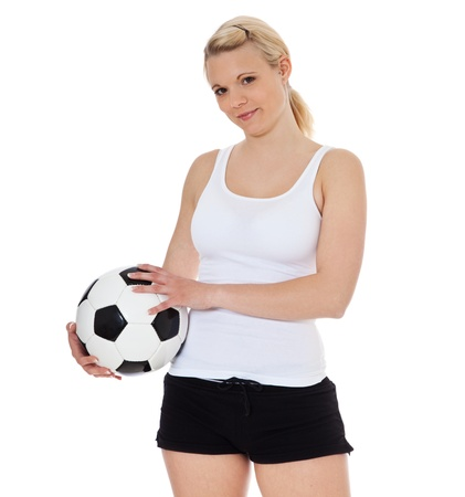sports wear: Young woman in sports wear holding soccer ball