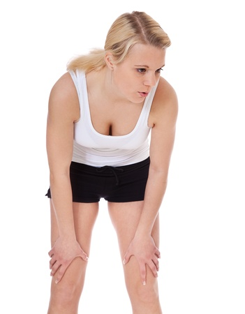 sports wear: Exhausted young woman in sports wear Stock Photo