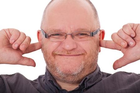 keeps: Grownup man keeps his ears shut